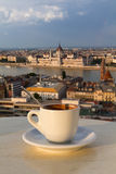 Cup of coffee with a view of the parliament building in Budapest Stock Photography