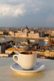 Cup of coffee with a view of the parliament building in Budapest Stock Image