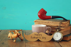 Cup of coffee with vintage father& x27;s accessories. Father& x27;s day co Royalty Free Stock Image