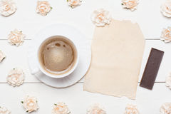 Cup of coffee and vintage paper sheet with empty copyspace and r Royalty Free Stock Photos