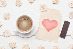 Cup of coffee and vintage paper sheet with heart symbol and rose Royalty Free Stock Photo