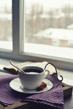 Cup of coffee on vintage tray. On sofa with open book royalty free stock photos