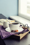 Cup of coffee on vintage tray Stock Photography