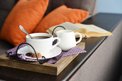 Cup of coffee on vintage tray Stock Photos