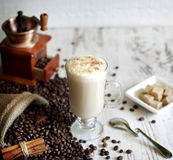 Cup of coffee on vintage white planks Stock Image