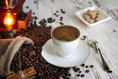 Cup of coffee on vintage white planks Stock Images