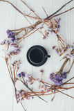 Cup of coffee and violet flowers. valentine`s day. Cup of coffee and violet flowers on a white background Stock Photos