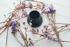 Cup of coffee and violet flowers. valentine`s day. Cup of coffee and violet flowers on a white background Royalty Free Stock Image