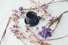 Cup of coffee and violet flowers. valentine`s day. Cup of coffee and violet flowers on a white background Stock Photography