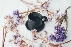 Cup of coffee and violet flowers. valentine`s day. Cup of coffee and violet flowers on a white background Royalty Free Stock Photography