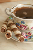 Cup of coffee and wafer biscuit rolls Stock Image