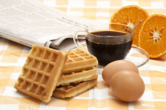 Cup of coffee, waffles, eggs, orange Royalty Free Stock Images