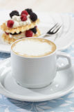 Cup of coffee and waffles with fruits Stock Image