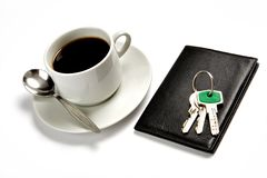 A cup of coffee, a wallet Royalty Free Stock Photography