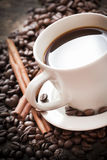 Cup of coffee in warm lighting. Stock Photo