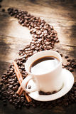 Cup of coffee in warm lighting. Royalty Free Stock Images