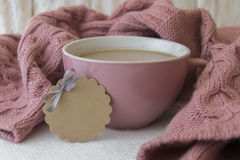 Cup of coffee and warm pink sweater royalty free stock photo