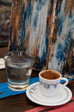 Cup of  coffee and water on a coffee shop Stock Photography