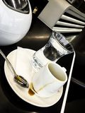 Cup of coffee with water glass royalty free stock photography