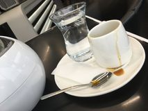 Cup of coffee with water glass stock photos