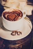 Cup of coffee, wedding rings and wedding bouquet Stock Images