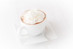 A cup of coffee with wheap cream, isolated, vignetted Royalty Free Stock Photos