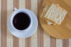 Cup of coffee with wheat cracker in breakfast time Royalty Free Stock Photography