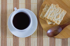 Cup of coffee with wheat cracker in breakfast time. Eat a breakfast or snack Stock Images