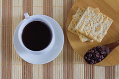 Cup of coffee with wheat cracker in breakfast time. Eat a breakfast or snack Royalty Free Stock Image