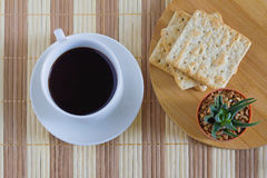 Cup of coffee with wheat cracker in breakfast time. Eat a breakfast or snack Stock Image