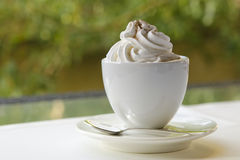 Cup of coffee with whip cream. In cafe Royalty Free Stock Image