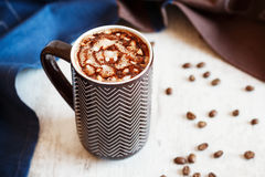 Cup of coffee with whipped cream and melted chocolate Stock Photo