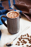 Cup of coffee with whipped cream and melted chocolate Royalty Free Stock Photo
