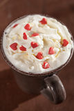 Cup of coffee with whipped cream and red hearts Stock Photography