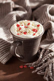 Cup of coffee with whipped cream and red hearts Royalty Free Stock Photos