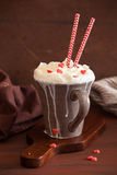 Cup of coffee with whipped cream and red hearts Royalty Free Stock Images