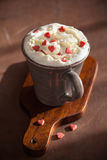 Cup of coffee with whipped cream and red hearts Stock Images