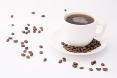 Cup of coffee on a white background with beans Royalty Free Stock Images