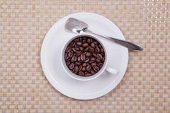 Cup of coffee. White cup with coffee beans Royalty Free Stock Photography