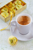 Cup of coffee with white chocolate candy. Cup of coffee and white chocolate candy heart Stock Photo