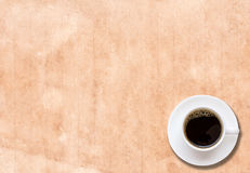 Cup of coffee in a white cup on paper texture Royalty Free Stock Images