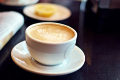 Cup of coffee. A cup of white hot coffee Stock Photography