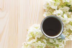 Cup of coffee and white hydrangea Stock Photo
