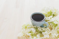 Cup of coffee and white hydrangea Stock Photography