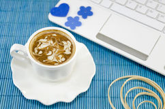Cup of coffee with a white lap top Royalty Free Stock Images