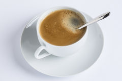 Cup of coffee on a white plate on white background Royalty Free Stock Photography