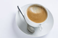 Cup of coffee on a white plate on white background Stock Photography