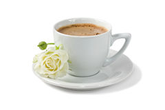A cup of coffee with white rose isolated on white. Background Royalty Free Stock Photos