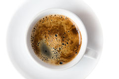 Cup of coffee on white saucer. White background stock image