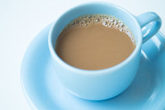 Cup of coffee on white table. Blue cup of coffee on white table Royalty Free Stock Photo